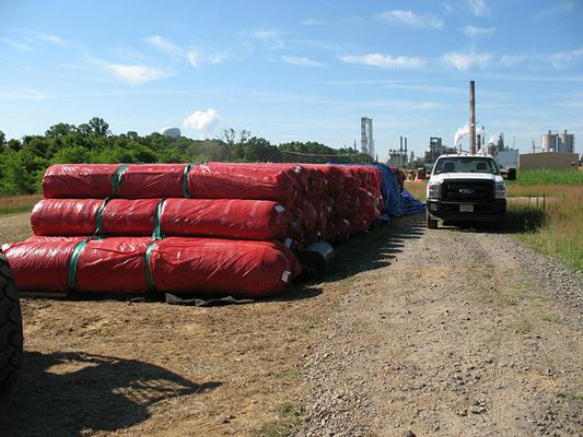 Rolls of Geosynthetic Clay Liner prior to installation