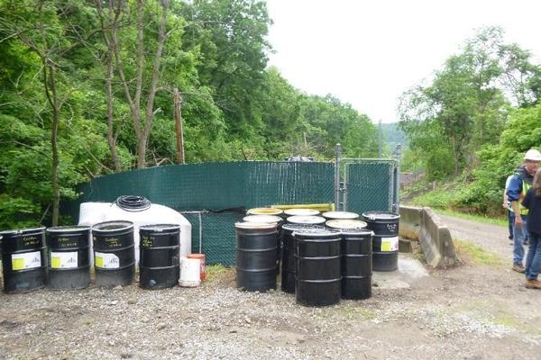 drums of spent carbon and oil staged for proper disposal