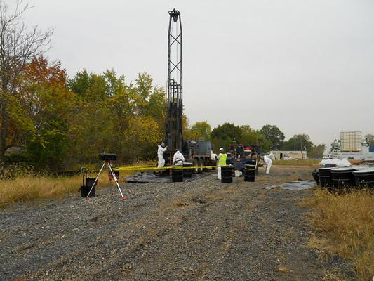 Installation of groundwater well and air sampling during Remedial Investigation
