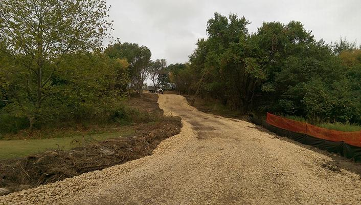 Access road to top of landfill for storage of soils.