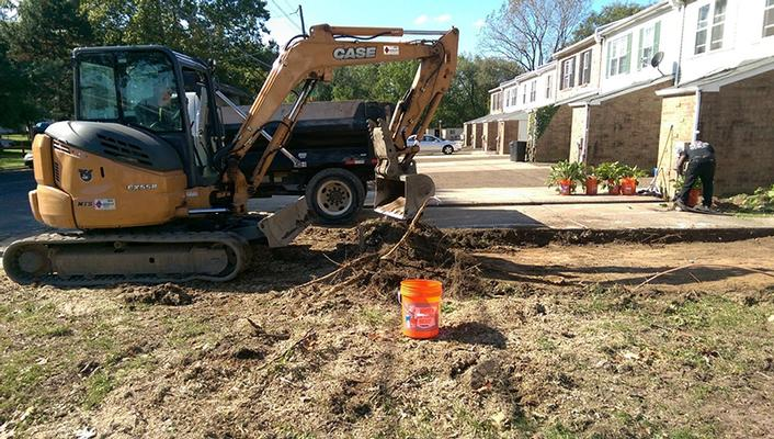Excavation of soil in front yards as part of residential yard cleanup.