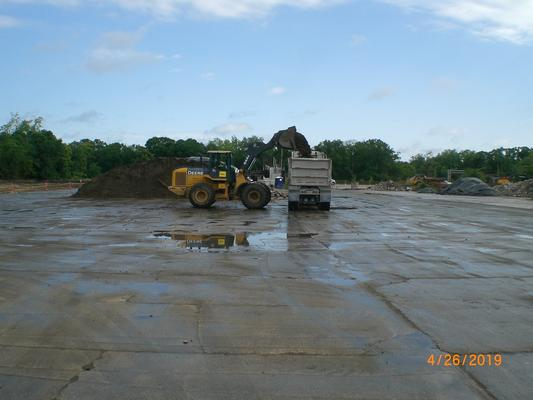 Loading trucks with impacted soil