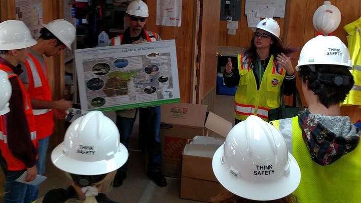 A class from Alma Collage learns about site safety and system installation in October 2017.