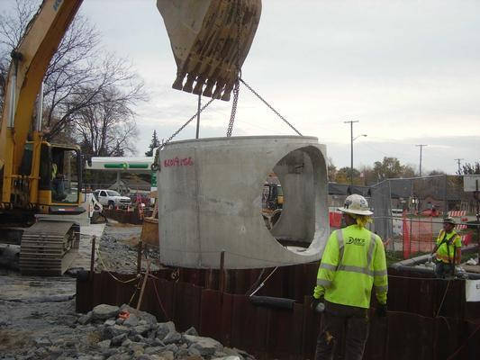 Installation of pre-cast manhole vault
