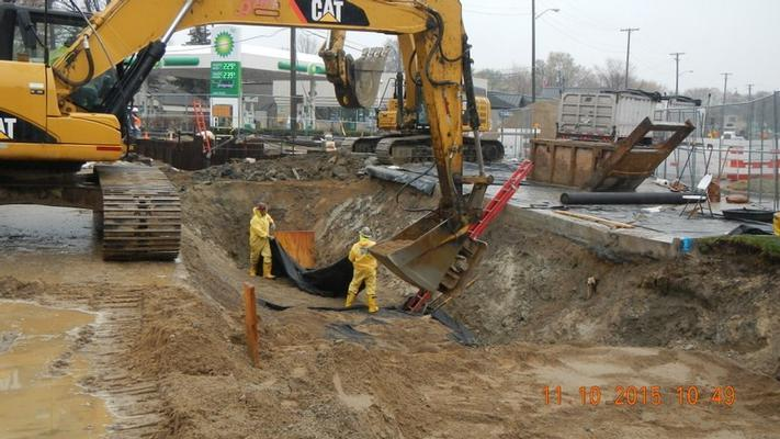 Preparing to install the 120-foot length of a new pipe between the two manhole vaults