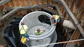 Installation of pre-cast vaulted manhole.