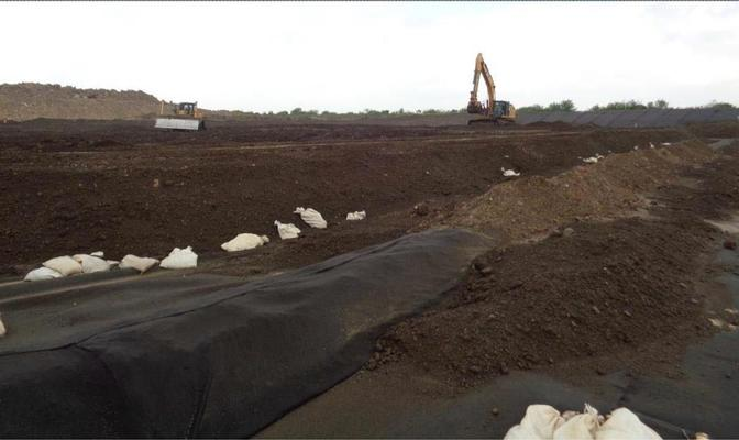 Placement of Solidified Sludge into RCRA Subtitle C Cell (landfill)