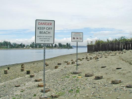 At the Wyckoff-Eagle Harbor Superfund Site on Bainbridge Island, Washington, beach visitors are advised to observe posted beach warning signs to avoid creosote contamination hazards at East Beach and North Shoal.
